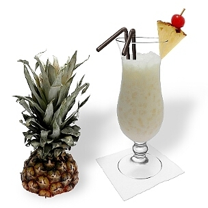 Batida de Coco in a hurricane glass, the most common way of presenting that delicious summer cocktail.
