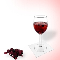 Berry punch in a red wine glass.