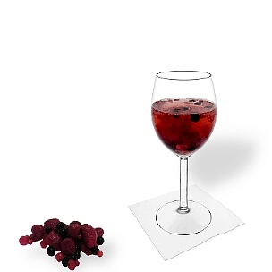 Berry Punch served in a red wine glass, the common way of presenting that delicious party mixture.