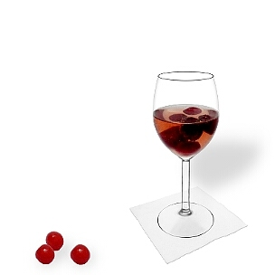 Cherry Punch served in a red wine glass, the common way of presenting that delicious party mixture.