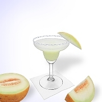 Frozen Melon Margarita served in a margarita glass with a slice of melon and a sugar or salt rim.