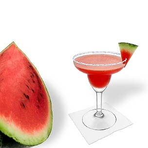 Frozen Watermelon Margarita served in a Margarita glass with a watermelon triangle and sugar or salt rim, the common way of presenting that fruity tequila cocktail.