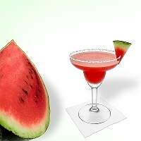 Frozen Watermelon Margarita served in a margarita glass with watermelon decoration and sugar or salt rim.