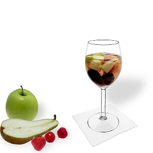 Fruit Punch served in a red wine glass, the most common way of presenting that delicious party mixture.