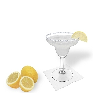 Margarita served in a Margarita glass with a slice of lemon and a sugar or salt rim, the common way of presenting that refreshing tequila cocktail.