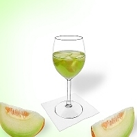 Melon punch in a red wine glass.