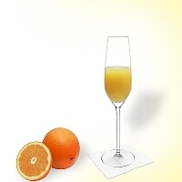 Mimosa in a champagne glass.