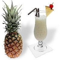 Piña Colada in a hurricane glass type Gibraltar