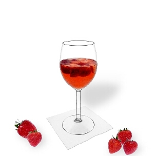 Strawberry Punch served in a red wine glass, the common way of presenting that delicious party mixture.